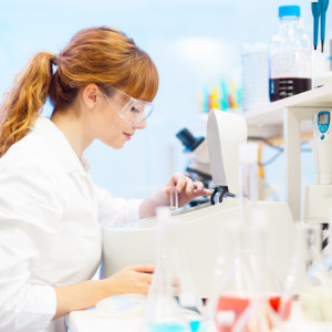 young scientist pipetting