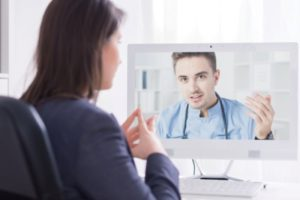 doctor on a screen with patient watching